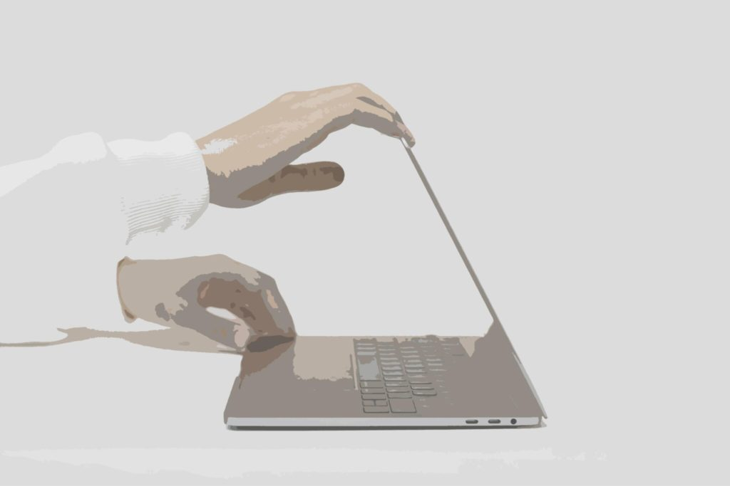 Person using laptop to develop cybersecurity strategy using RegTech
