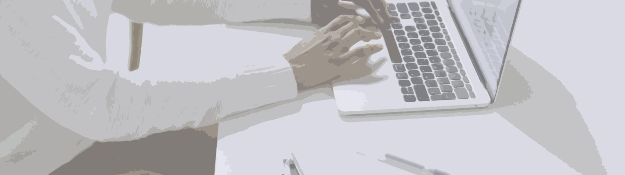Person on laptop creating cybercrime strategy using RegTech in finance